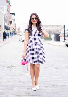 Bucket bag, rounded sunnies, patterned dress, pearled necklace, white pumps, street style, ootd