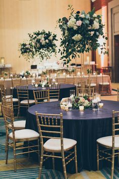 Tall centerpieces for a ballroom wedding at the Ritz Carlton Charlotte, Greenery wedding flowers and centerpiece ideas, Navy blue linens, Ballroom Wedding Ideas