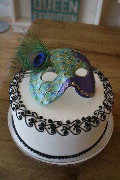 Peacock mask on cake
