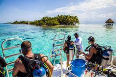 http://pin.sanctuarybelize.com      Prepping for the scuba dive near Sanctuary Belize's 6 acre private island.