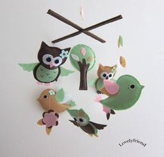 like how the owls face the baby....could make my own with an embroidery hoop (like the hoop idea more than the cross)...but with nursery rhymes and using the colors of her room