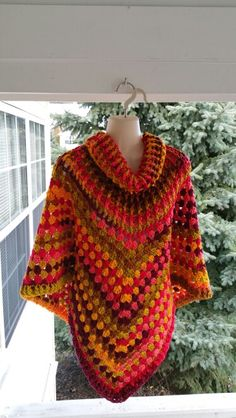 Hot Off My Hook! Project: My 50th Cowl-Neck Poncho Started: 14 Nov 2015 Completed: 15 Nov 2015 Model: Madge the Mannequin Crochet Hook(s): 7mm, Cowl portion, K, Granny Stitch portion Yarn: Bernat Super Value Stripes Color(s): Spice Stripes Pattern Source: Simply Crochet Magazine, Issue No. 25 (Hard Copy) Pattern Designed By: Simone Francis Notes: This is my 50th Cowl-Neck Poncho!
