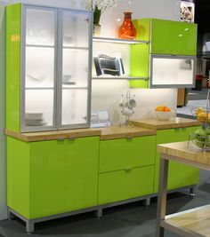 High-gloss kitchen cabinets in kiwi green! From Element Designs. They have more classic colors too, if you prefer.