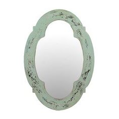 Weathered wall mirror with a quatrefoil-style frame. Product: Wall mirrorConstruction Material: Wood and mirrored glassColor: Distressed greenDimensions: 28 H x 19.5 W x 1 DCleaning and Care: Wipe with clean damp cloth