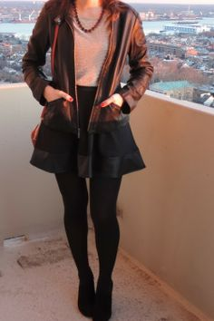 See What Katie Wears: Leather jacket, gold shimmer top, purple necklace, faux-leather skirt, tights, ankle boots