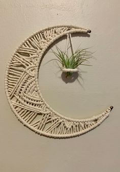 Macrame moon wall hanging that holds air plants or even a crystal! This moon was made and designed with care and love. Crochet Plant Hanger, Macrame Plant Holder, Plant Holders, Mobiles, Paracord, Macrame Bracelet Diy, Macrame Wall Hanging Diy, Moon Decor, Macrame Design