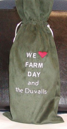 Custom embroidered wine bags.  Don't show up at your next party without one for the host!