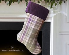 A classic plaid stocking made of extra soft and cozy brushed 100% cotton includes shades of purple, cream, beige and moss green. Traditionally designed, timelessly stylish - and perfect for adding that festive feel to your home this Christmas! Plaid fabric is presented on both sides of the stocking, allowing it to be displayed to the left or right. Meticulously sewn with cotton interlining ensures it will hold its form over time. Stocking is fully lined with sturdy beige linen cotton…