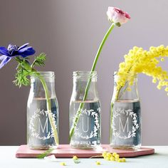 Personalised 'Mum' Bottle Bud Vases. These bottles are the perfect size to display individual blooms of your favourite flowers, which will brighten up any windowsill or mantelpiece.