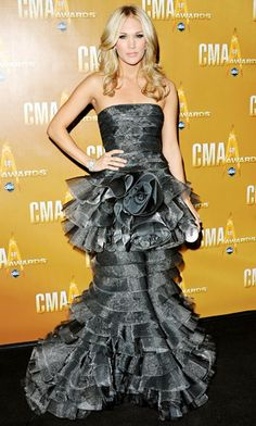 Underwood arrived at the 2010 CMA Awards in a tiered strapless Talbot Runhof gown paired with a Swarovski crystal clutch.