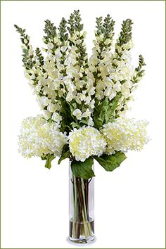 Hydrangea and Snapdragon Bouquet: An all white tall bouquet with artificial flower stems of Hydrangea and Snapdragons combined. An exquisite arrangement that is secured in clear acrylic solution in a 13