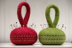 """Felted Pin Cushion / Pattern Weights - More from the creative hands of """"Ompompal Claudia"""" - https://flic.kr/p/jFJyGX   felted pin cushions - pattern weights   Felted these pin cushions which could also be used as pattern weights as they are quite heavy. I felted two metal rings inside to achieve more weight. I like carrying my pincushions around when I am working and they are just right!"""