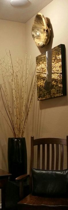"""Handmade Chair crafted with care and """"Amish Sensibility .""""  It anchors,  above it,  original artisanry in wood, and a palette knife oil  """"Autumn Aspen Tree"""" study.  Carefully curated pieces by this homeowner warm a newly built home in Colorado."""