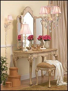Vintage decor - Ladies dressing table with matching bench. Tri-fold mirror. Singular Wall sconces with crystals accent the matching chandelier.