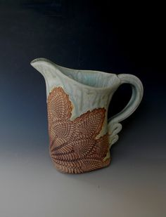 The perfect iced tea pitcher or just water on the table, this pitcher is textured with a traditional pineapple lace impression which brings