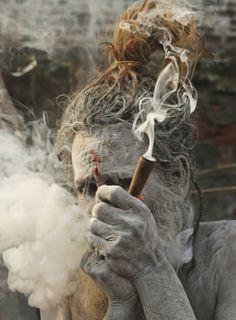 Hindu holy man has a smoke ahead of the Kumbh Mela mass pilgrimage in Allahabad, India Photos Of Lord Shiva, Lord Shiva Hd Images, Lord Hanuman Wallpapers, Lord Shiva Hd Wallpaper, Smoking Photos, Smoking Images, Aghori Shiva, Baby Rhino, Hd Cool Wallpapers
