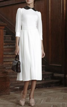 Rendered in wool, this **Ulyana Sergeenko** dress features embroidered floral…