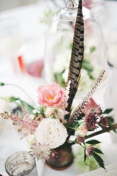 #feathers, #centerpiece  Photography: Lisa Poggi Photography - lisapoggi.com Event Planning + Design: Chic Weddings in Italy - chicweddingsinitaly.com/ Floral Design: La Rosa Canina - larosacaninafioristi.it/rosacanina.html  Read More: http://www.stylemepretty.com/2013/06/18/tuscany-wedding-from-lisa-poggi-photography/