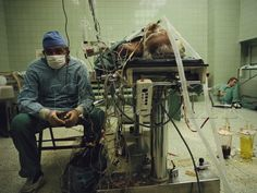1987, James Stanfield; Amidst a tangle of wires Dr. Zbigniew Religa anxiously watches a monitor to see how his patient responds after a heart transplant. He has just completed the second of two transplants in 21 hours.
