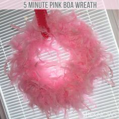5 minute wreath--If you are looking for simple, low-cost baby shower decorations, making this pink feather boa wreath will be right up your alley.