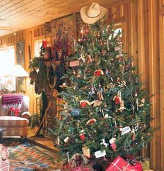 A tree with a western theme--lights, ornaments and a cowboy hat on top