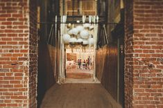Lanterns dipped in gold in the entry way // Los Angeles Warehouse Wedding: Stephanie + Scott