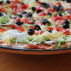 Taco dip! Bottom layer- a mix of cream cheese, sour cream, and taco seasoning; topped with a layer of salsa, lettuce, cheese, diced tomato, olives, and chopped green onion. Delicious!