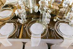 buenovallewedding karina jensen jellyfishpuntacana wedding gold white destination wedding beach wedding decor details centerpiece jellyfish decoration plate napkins glass mirror table top candle center plate