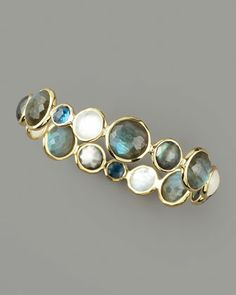 Faceted Multi-Stone Bangle by Ippolita at Bergdorf Goodman.  Round-cut labradorite, London blue topaz, and light blue topaz stations of varying size.  Hammered 18-karat yellow gold settings.  Slip-on style.  Imported.
