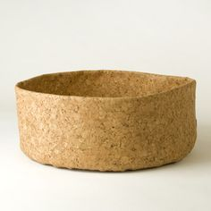Adjust A Bowl, by Rachel Speth. Made from pliable, stain-resistant cork fabric, machine washable. ($35)