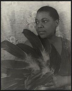 Van Vechten's Portrait of Bessie Smith holding feathers. 1936