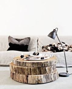 Huge wood slabs as coffee table. Amazing!