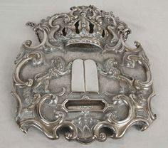 Silver adornment for a Torah scroll- one of the many religious objects plundered by the Nazis for transfer to Germany.