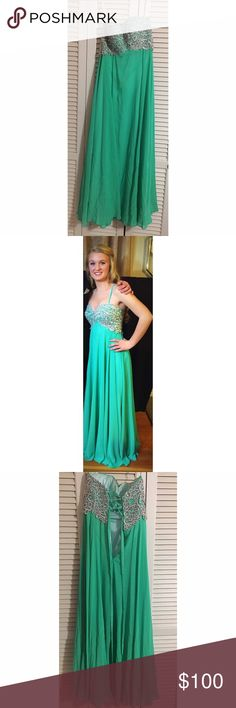 """Prom dress Long, mint green prom dress. I wore it once and absolutely loved it. It fits a small, size 3/4, the straps in the back are adjustable so it can go smaller/ bigger. I am 5'4"""" and it fit me well with heels on. Message me if interested, may be willing to go down on the price! Dresses Prom"""