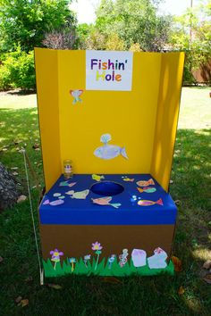 Fishing game for carnival birthday party.  I am sure I could make something like this!