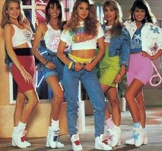 in this picture , womens wear a crop-top , demin jeans and SNEAKERS , sneaker is come from 1980s . it's one of the trends in this decade and now from mid 2013-2014 it still a popular style