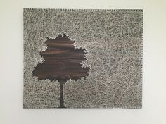 """Tree String Art. Negative image on a dark stained wood board. 18"""" by 24"""""""