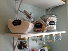 Laundry room storage - I LOVE the jars attached to the shelf!!