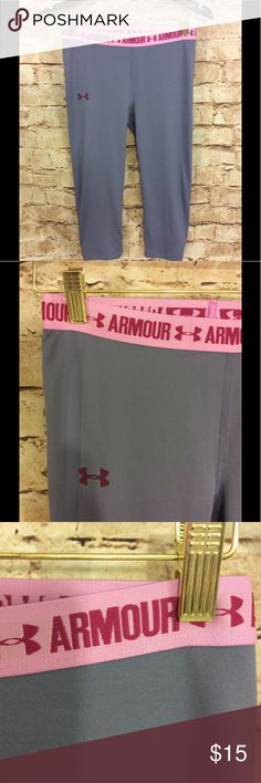 Under armour gray workout pants medium/large Nice under armour gray workout pants Elastic waist band w/shades of purple detail Medium/large there is not a definite size label so please go by measurements Capri length Inseam is 17 inches Waist is 14 inches stretches up to 20 inches Hip is approximately 15 inches stretches of the 20 inches or more Rise is 9 inches Under Armour Pants Capris
