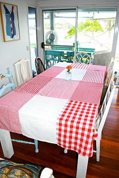 Idea: making a table cloth from tea/kitchen towels - new or used. Great idea!