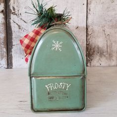 Frosty painted on Vintage metal lunch box. Pleas see all pictures. He is painted over the V logo. Hand painted snowman is antiqued, flicked with white for snow and sealed. Finished with homespun, a sprig of greens, wood tag and mica snow .  It would look any where especially your kitchen for winter decor.  10L x 7 1/4H x 4 W The current tag says: Happy Holidays Customized the wood tag to say: Home For the Holidays, Happy Holidays, In the Meadow We can Build a Snowman, Ill Be Back Again…