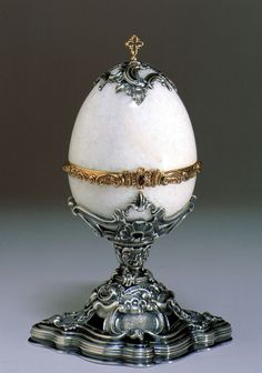 This Faberge egg is made of hand painted Limoges porcelain and ...