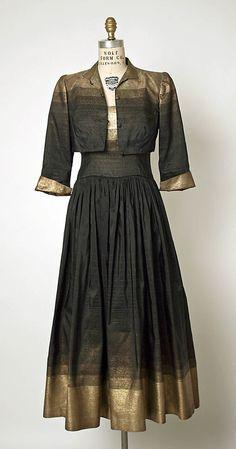 "Silk and metallic thread evening ensemble (sleeveless dress and jacket) by Gilbert Adrian, American, 1949-1950. Label: ""Adrian, Gunther Jaeckel"""