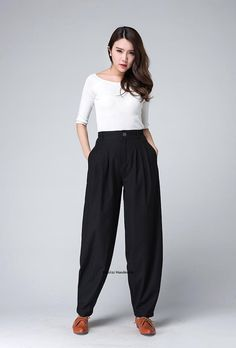 This Black pegged pants is crafted in soft black linen , featuring a fitted waist with pleated detail , two pockets on both side. Wear This vintage and retro inspired long pants and enjoy your casual weekend. DETAIL * Black linen maxi pants * A zipper and a buttons in the front side * Side