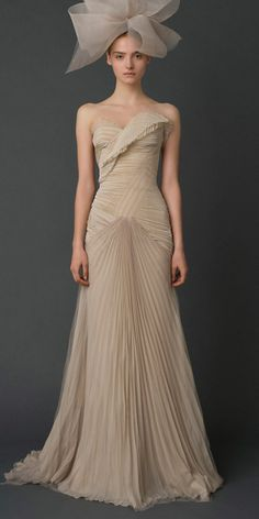 Vera Wang (I could do without the bow on the head), but the pleated, wrapped gown is lovely