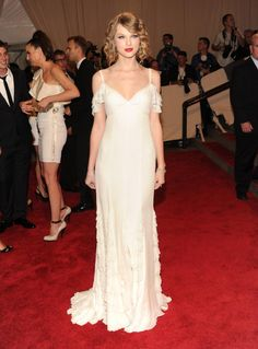 Taylor Swift in an off-the-shoulder white Ralph Lauren gown, does it get more American than this?