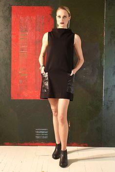 "No one does modernism like ""Project Runway"" Season 7 Star Mila Hermanovski! A slightly raised neckline and square leather pockets create a fierce mod look."