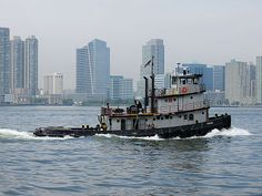 Tugboat on the Hudson River viewed from Battery Park City, Lower Manhattan, New York City. June 13, 2014.