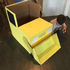 DIY cardboard bulldozer we made for a construction birthday party