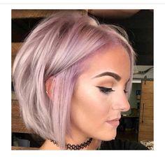 Killer pink and lilac hair color atop a beautiful bob haircut by…